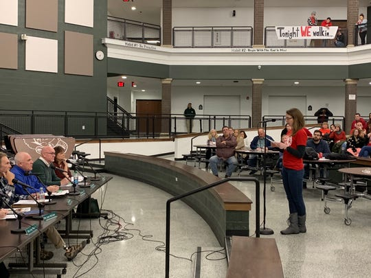 Kim Boehm, a Madison teacher, reads aloud a statement declaring Madison teachers will begin a soft strike Friday during the Madison School Board Meeting January 30, 2019.
