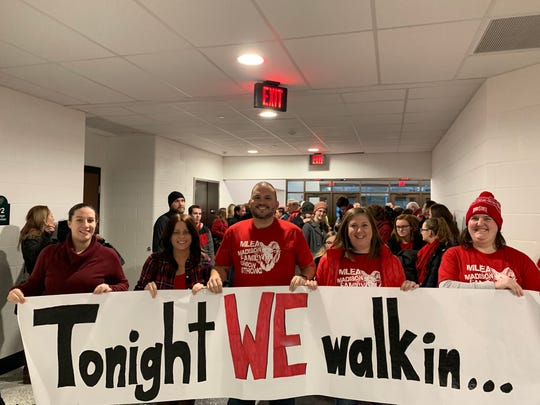 Members of the Madison Local Education Association (MLEA), a union that represents many Madison teachers, hold a banner prior to a Madison School Board meeting Wednesday, January 30, 2019.
