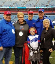 Pictured from left are Marion residents Jeff and Laura Hoppes along with Laura's nephew Zak Kromer, her brother Aaron Kromer and Aaron's wife Dawn when Aaron coached with the Buffalo Bills.