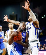 Memphis guard Alex Lomax (left) drives the lane against Tulsa defender Elijah Joiner (right) during action in Tulsa,  Wednesday, January 30, 2019.