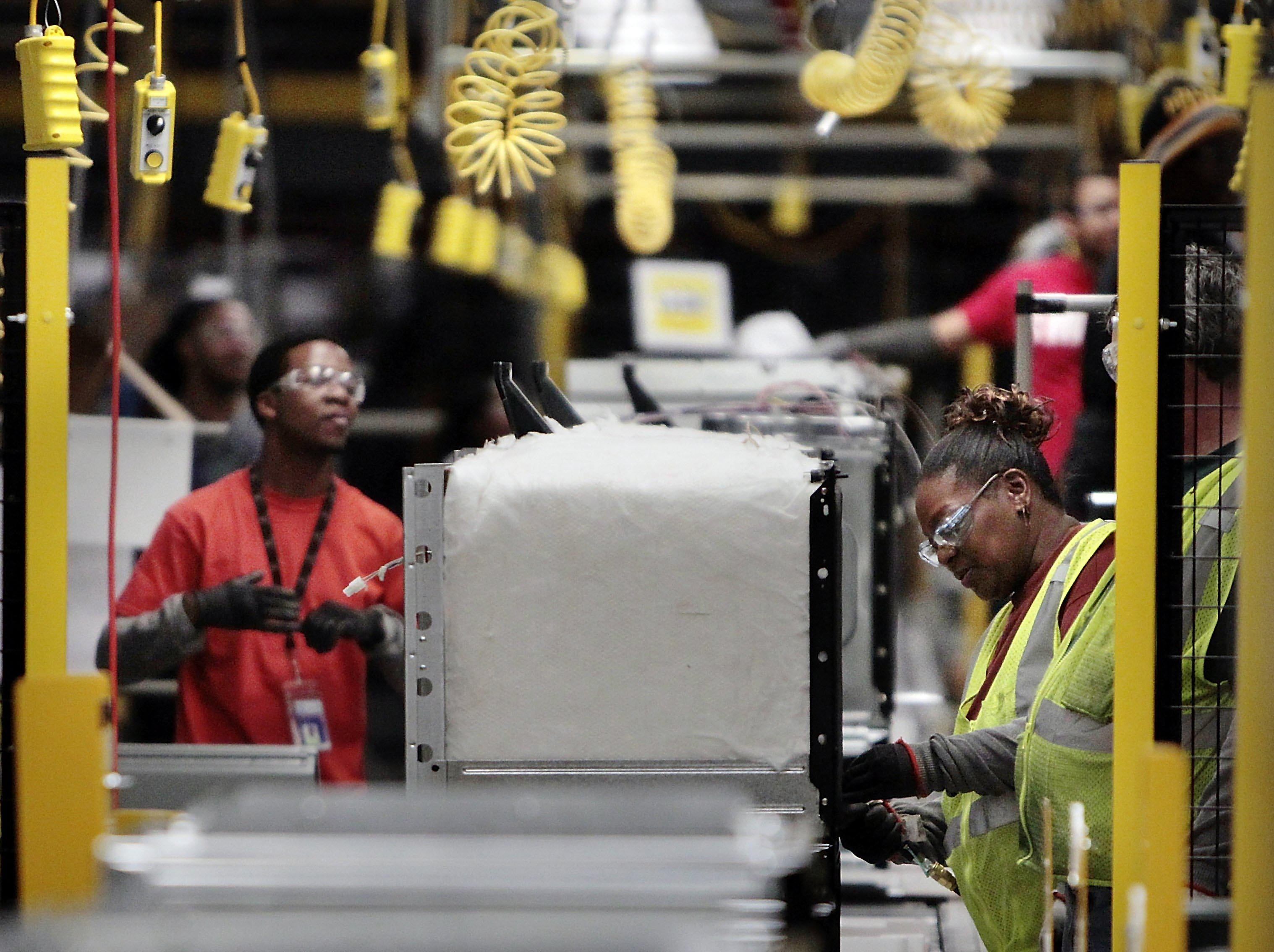 Tax breaks to attract companies and create jobs like these on the production line at Electrolux cost Memphis $16 million per year. (Jim Weber/The Commercial Appeal)