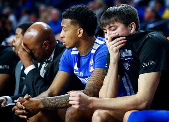 Memphis' David Wingett (right) looks on from the bench as the Tigers fall to Tulsa 95-79, Wednesday, January 30, 2019.