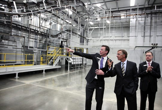 January 9, 2014 - Electrolux Plant Manager George Robbins, left, gives Tennessee Governor Bill Haslam a tour of the newly opened Electrolux plant Thursday morning. Local goverment representitives, Electrolux executives and the media were given a behind-the-scenes look at the city's newest manufactoring facility. (Jim Weber/The Commercial Appeal)