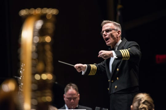 U.S. Navy band commanding officer Capt. Kenneth Collins leads the band during a performance.