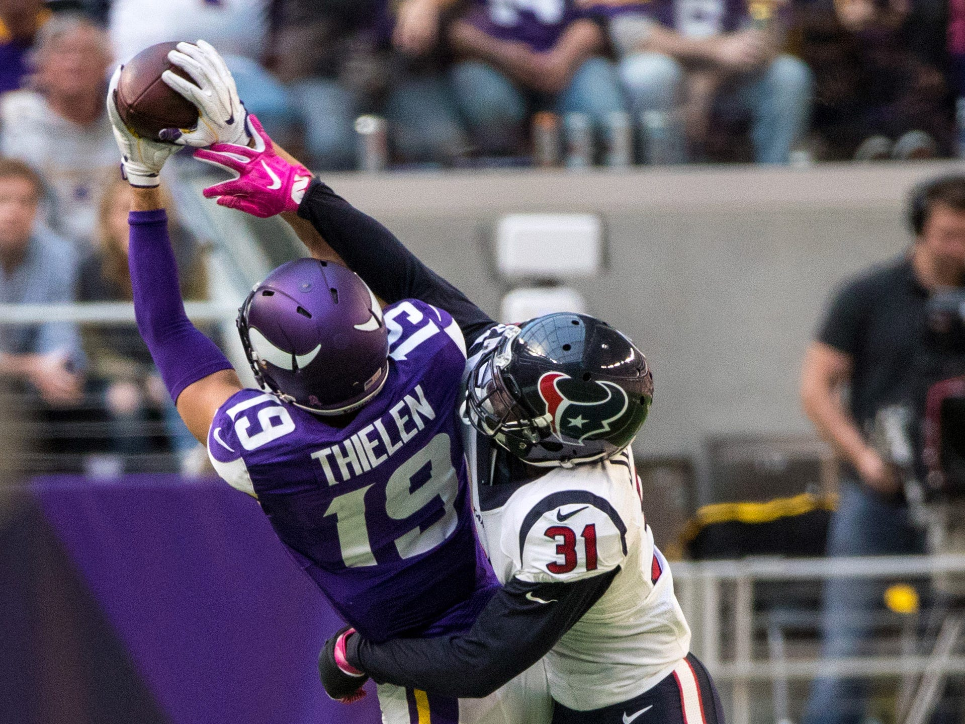 Oct 9, 2016; Minneapolis, MN, USA; Minnesota Vikings wide receiver Adam Thielen (19) catches a pass over Houston Texans cornerback Charles James II (31) during the fourth quarter at U.S. Bank Stadium. The Vikings defeated the Texans 31-13.