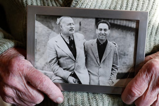"Ernest Hemingway's friend and biographer A.E. Hotchner holds a photograph of the pair together. When the 1958 film adaptation ""The Old Man and the Sea"" hit theaters, Ernest Hemingway told his Hotchner that he hated it and urged his writer pal to do his own adaptation someday. Now 101, and with his son's collaboration, Hotchner has finally completed Hemingway's request and his stage adaptation of ""The Old Man and the Sea"" premiered Feb. 1 in Pittsburgh."