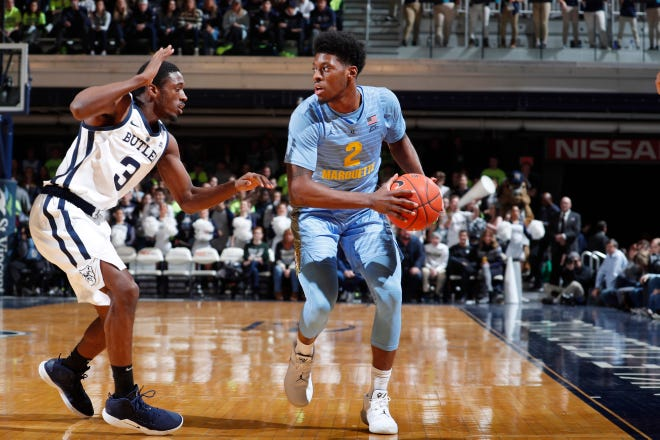 Marquette guard Sacar Anim scans the court to survey his options while being guarded by Kamar Baldwin of Butler during the first half Wednesday night.