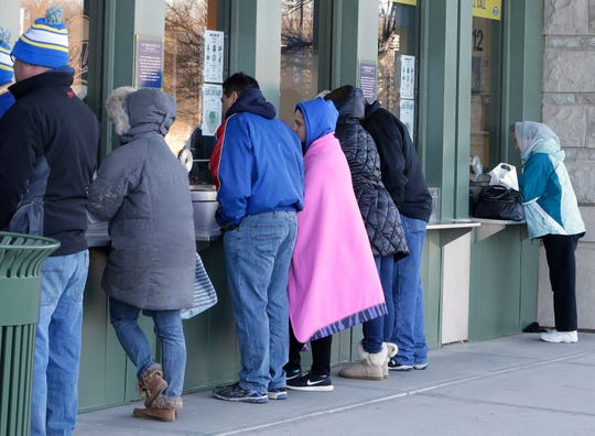 Brewers fans line up at the Miller Park box office to buy single-game tickets before last season.