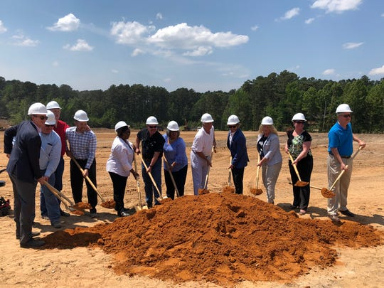 Ruston officials break ground on the new Ruston Marketplace shopping center in May 2018. The first stores in the new center will start opening in March.
