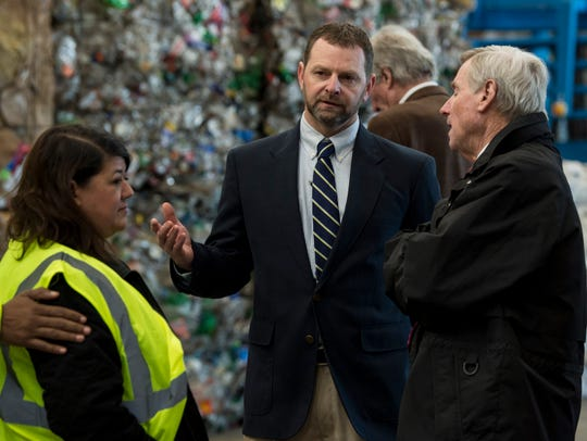 Plant Manager Tab Bruce speaks with Mayor Todd Strange during the opening of the RePower South recycling plant in Montgomery, Ala., on Thursday, Jan. 31, 2019.