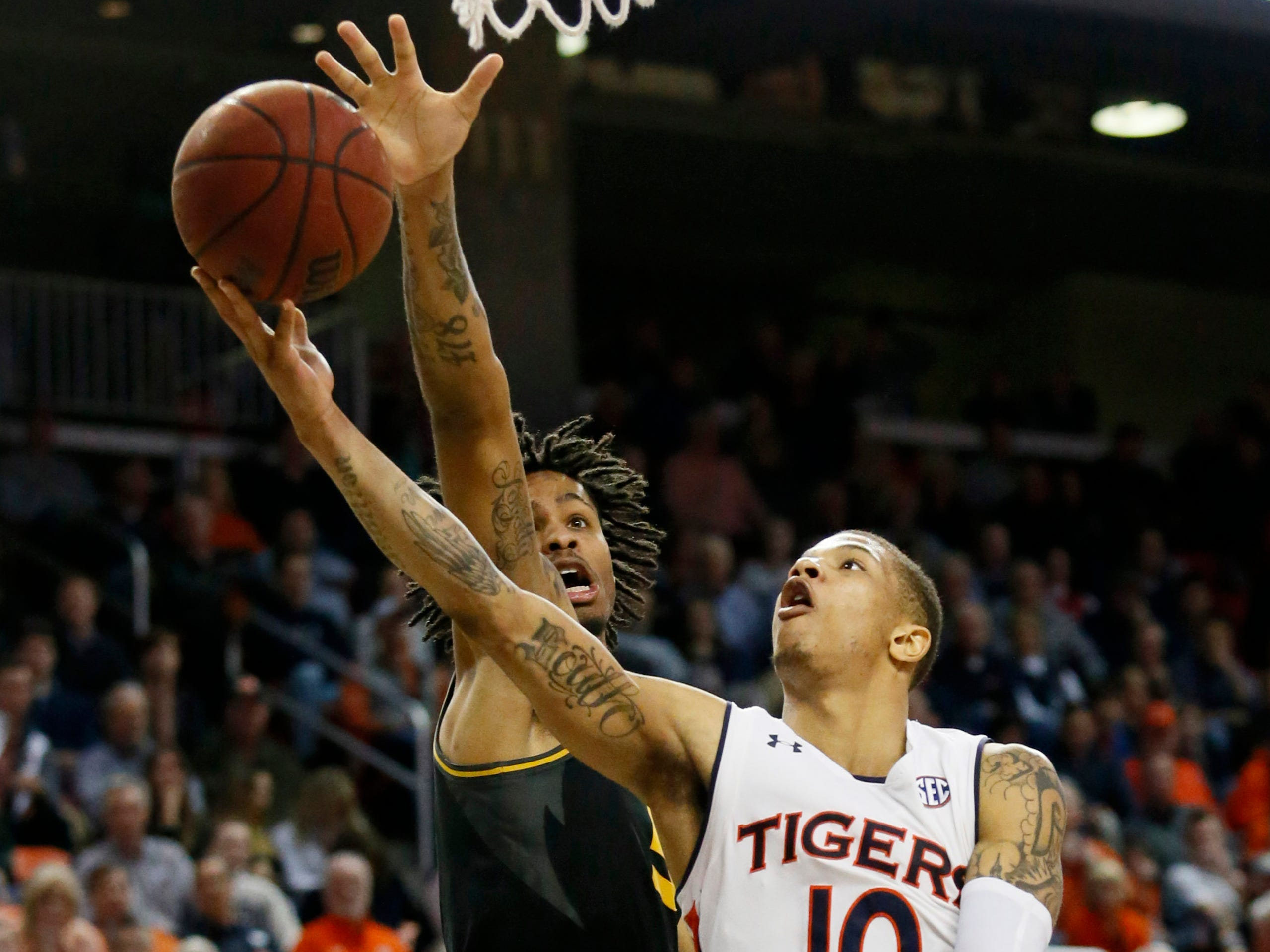 Jan 30, 2019; Auburn, AL, USA; Auburn Tigers guard Samir Doughty (10) shoots against Missouri Tigers forward Mitchell Smith (5) during the second half at Auburn Arena. Mandatory Credit: John Reed-USA TODAY Sports