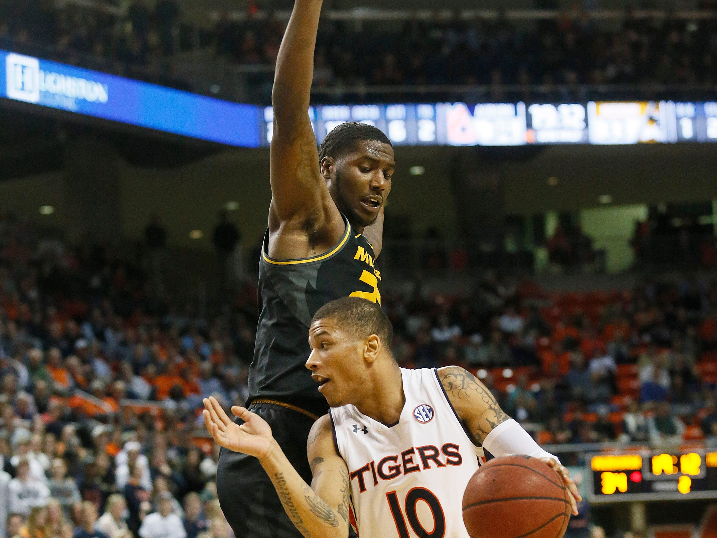 Jan 30, 2019; Auburn, AL, USA; Missouri Tigers forward Jeremiah Tilmon (23) tries to block Auburn Tigers guard Samir Doughty (10) during the second half at Auburn Arena. Mandatory Credit: John Reed-USA TODAY Sports