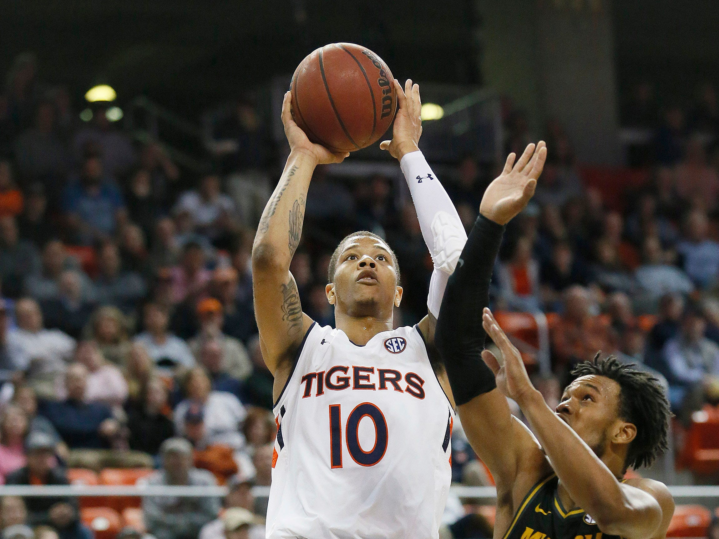 Jan 30, 2019; Auburn, AL, USA; Auburn Tigers guard Samir Doughty (10) shoots over Missouri Tigers guard Torrence Watson (0) during the second half at Auburn Arena. Mandatory Credit: John Reed-USA TODAY Sports