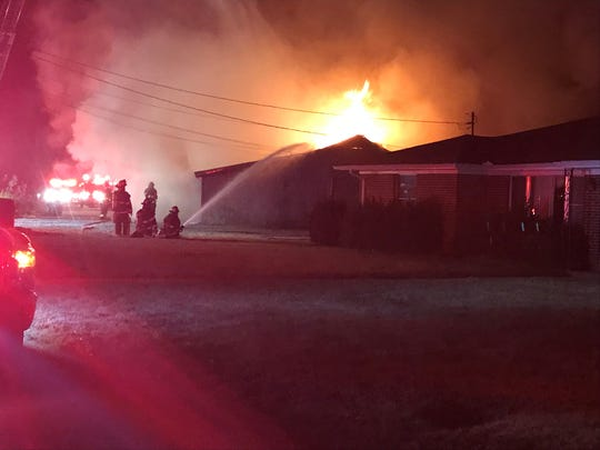A home under construction on Honeysuckle Road was engulfed in flames.