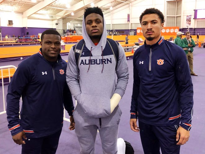 Auburn's Shaun Shivers (left), Noah Igbinoghene (center) and Anthony Schwartz (right) during the Bob Pollack Invitational in Clemson, S.C., on Friday, Jan. 25, 2019.