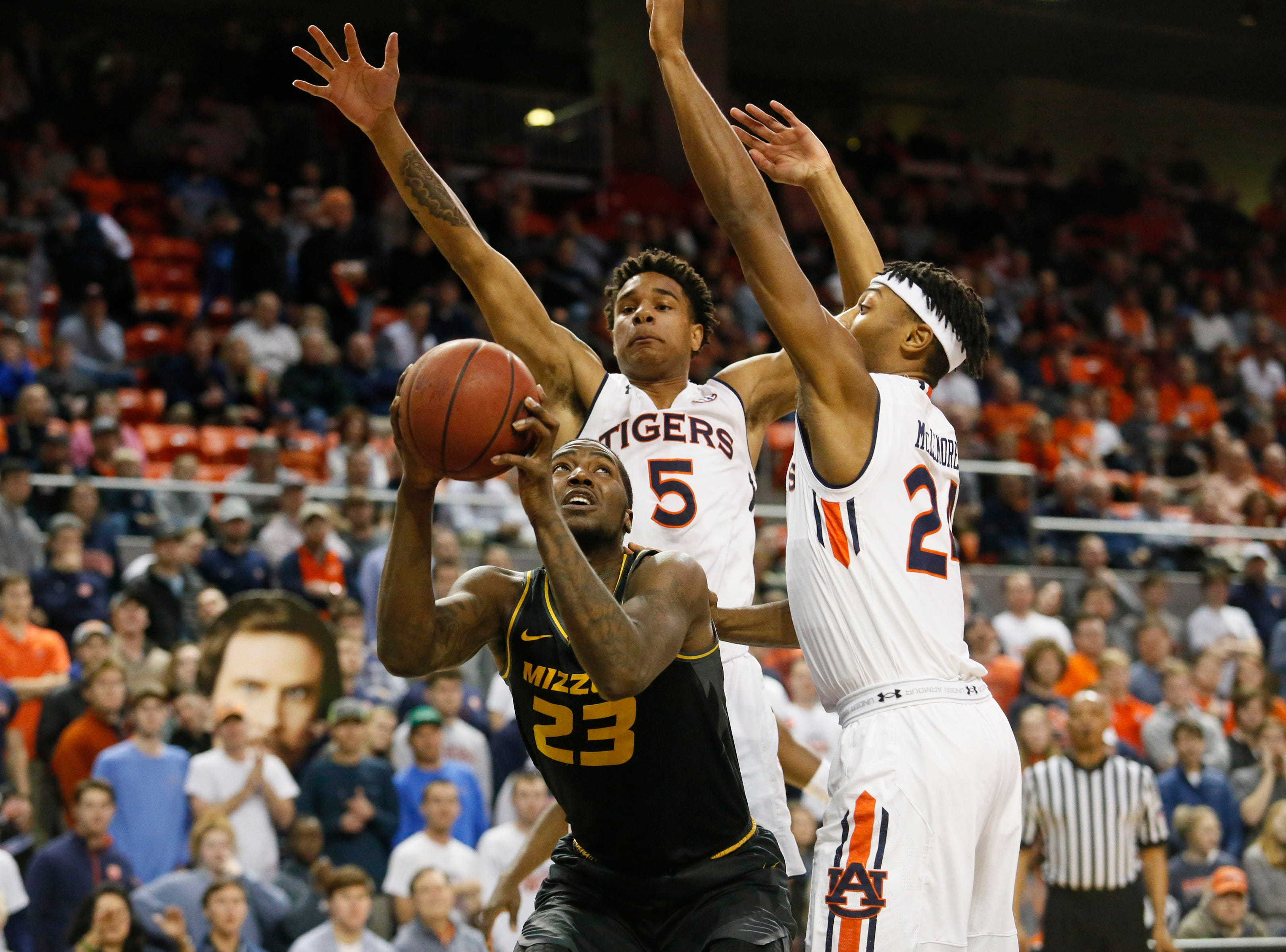 Jan 30, 2019; Auburn, AL, USA; Missouri Tigers forward Jeremiah Tilmon (23) shoots between Auburn Tigers forward Chuma Okeke (5) and forward Anfernee McLemore (24) during the first half at Auburn Arena. Mandatory Credit: John Reed-USA TODAY Sports