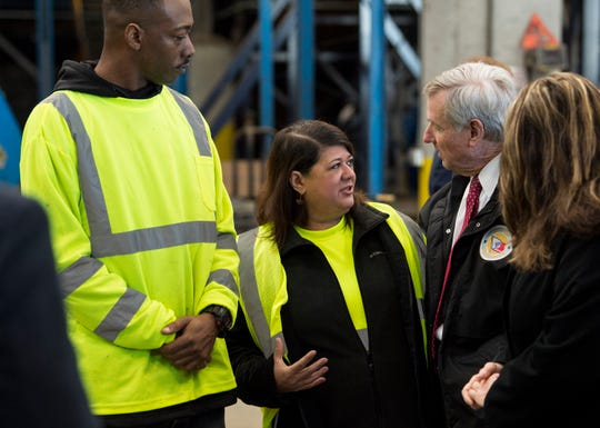 Mayor Todd Strange speaks with employees of the new recycling plat at the RePower South recycling plant in Montgomery, Ala., on Thursday, Jan. 31, 2019.