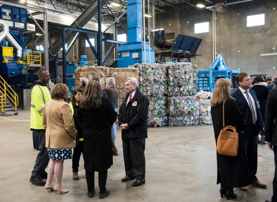 Mayor Todd Strange speaks with RePower South employees at the opening of the new RePower South recycling plant in Montgomery, Ala., on Thursday, Jan. 31, 2019.