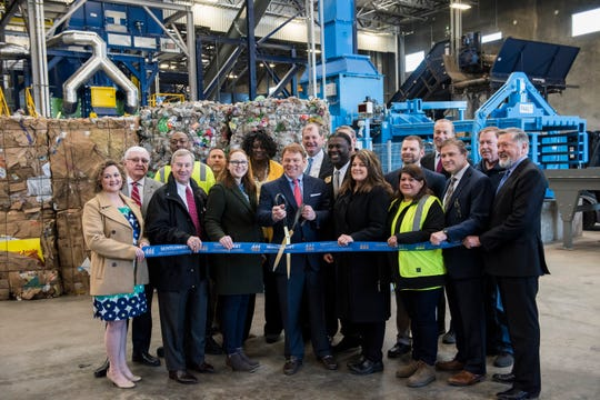 Local officials and RePower South employees cut the ribbon opening the RePower South recycling plant in Montgomery, Ala., on Thursday, Jan. 31, 2019.