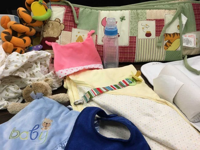 Safe sleep trainer Sue Nunez uses bumper pads, pacifiers with straps, loose sheets and other items to teach what doesn't belong in a baby crib.