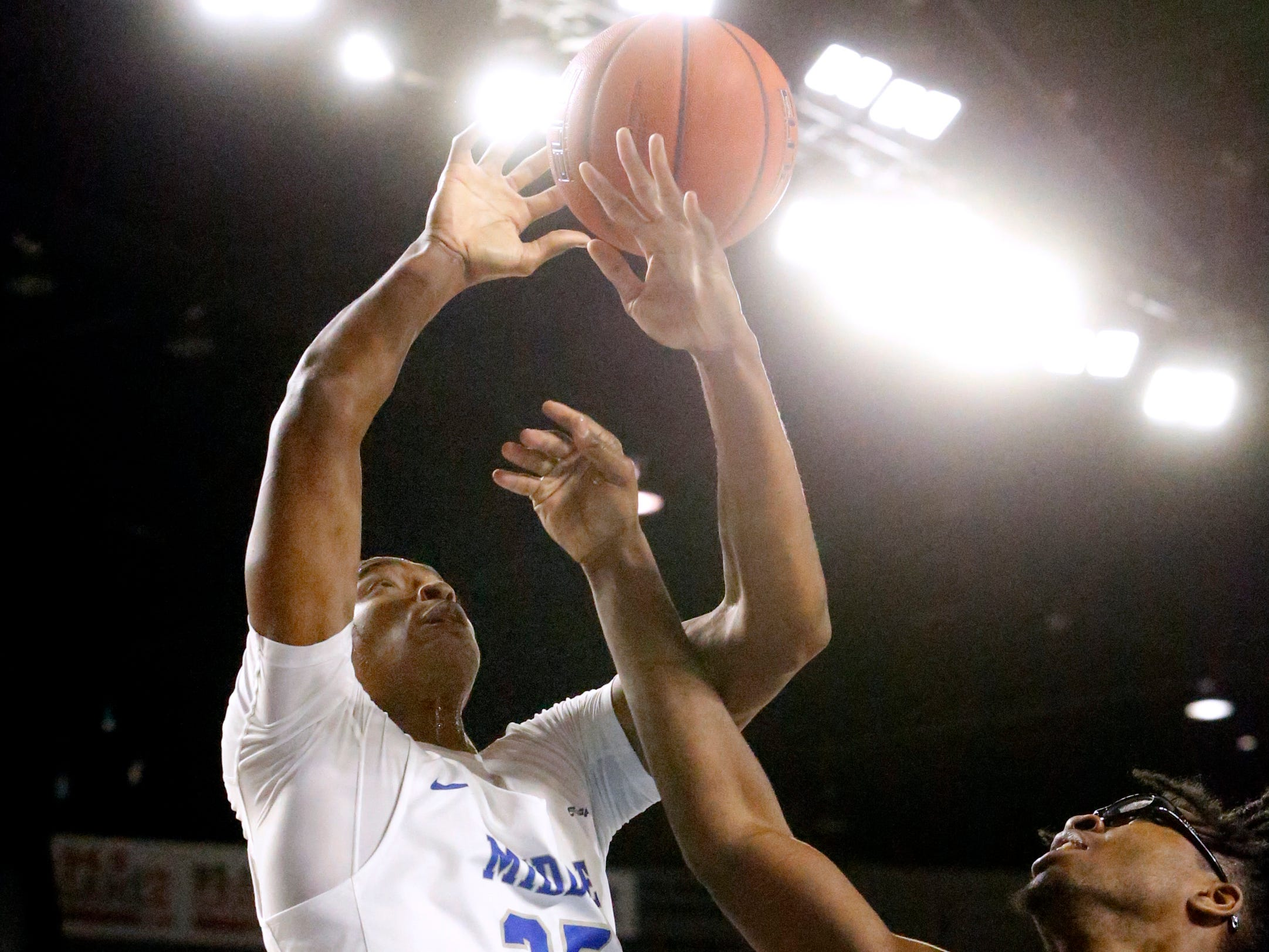 MTSU forward Karl Gamble (25) goes after a rebound with UAB's forward Tamell Pearson (11) on Wednesday Jan. 30, 2019.