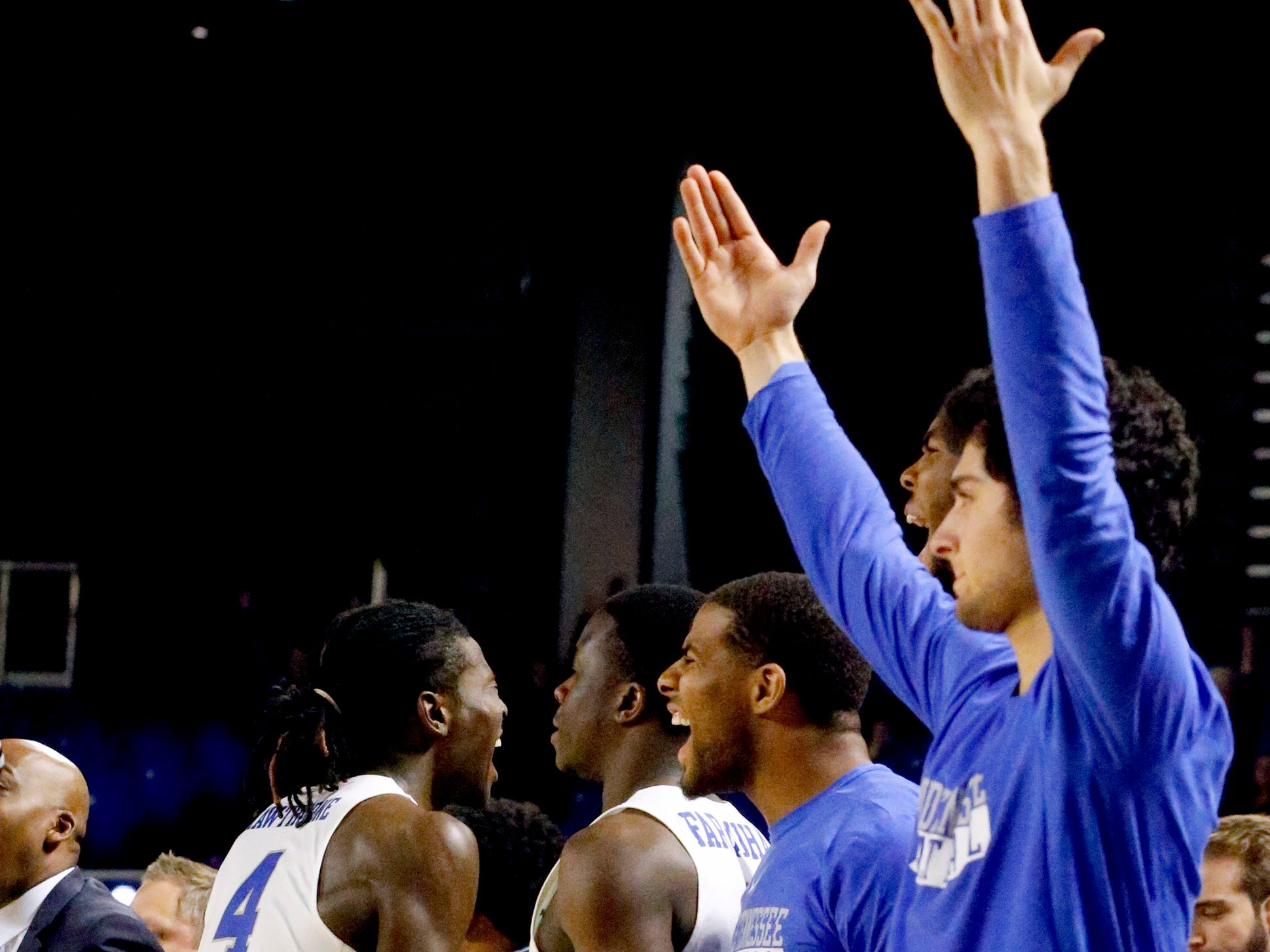 MTSU's bench celebrates after  MTSU guard Donovan Sims (3) makes a three point basket against UAB late in the second half on Wednesday, Jan. 30, 2019.