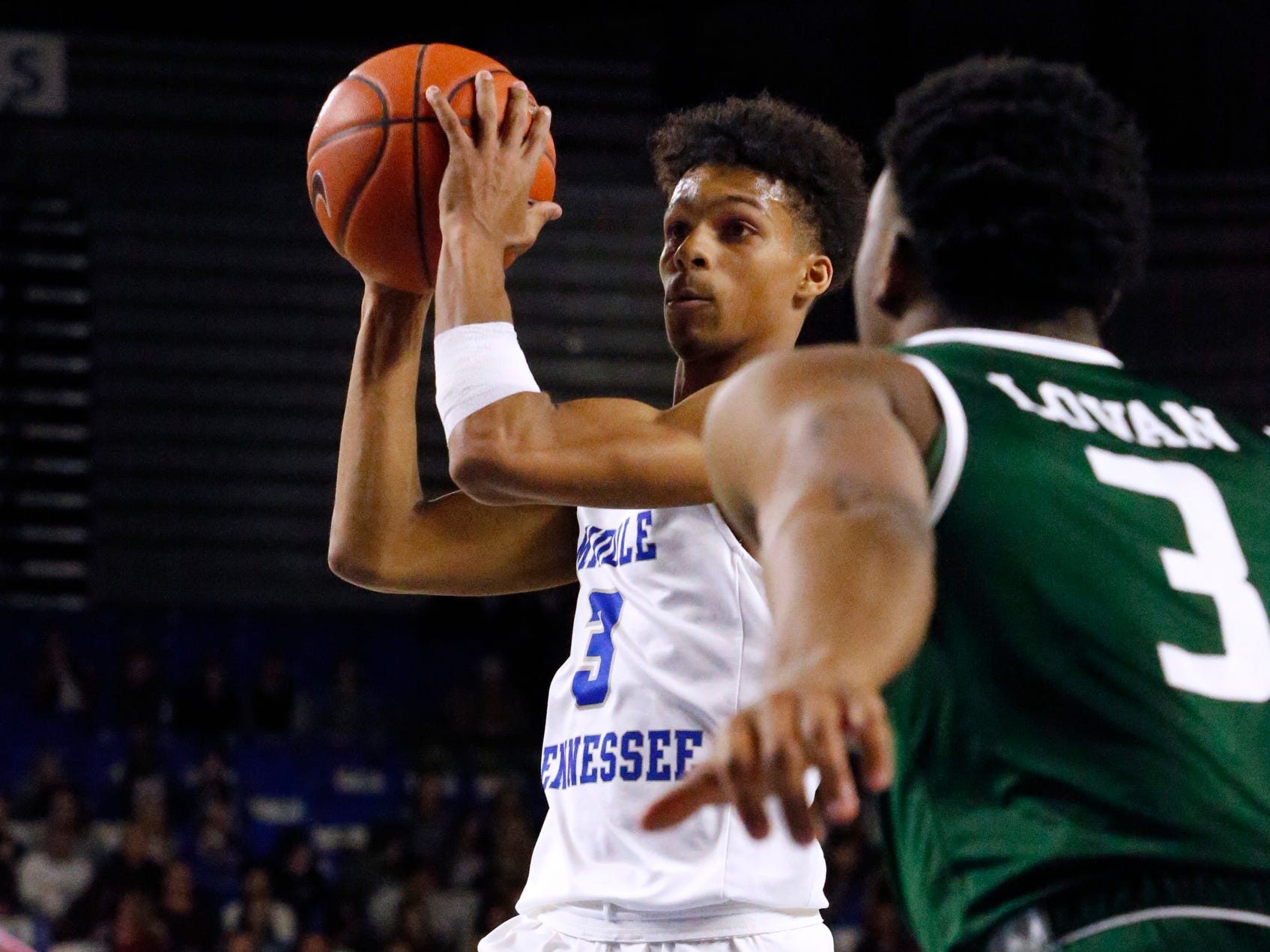 MTSU guard Donovan Sims (3) goes up for a shot as UAB guard Tavin Lovan (3) guards him on Wednesday Jan. 30, 2019.