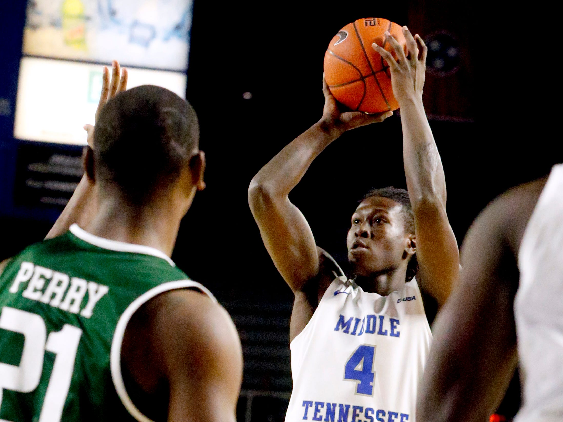 MTSU forward James Hawthorne (4) goes up for a three point basket on Wednesday Jan. 30, 2019.