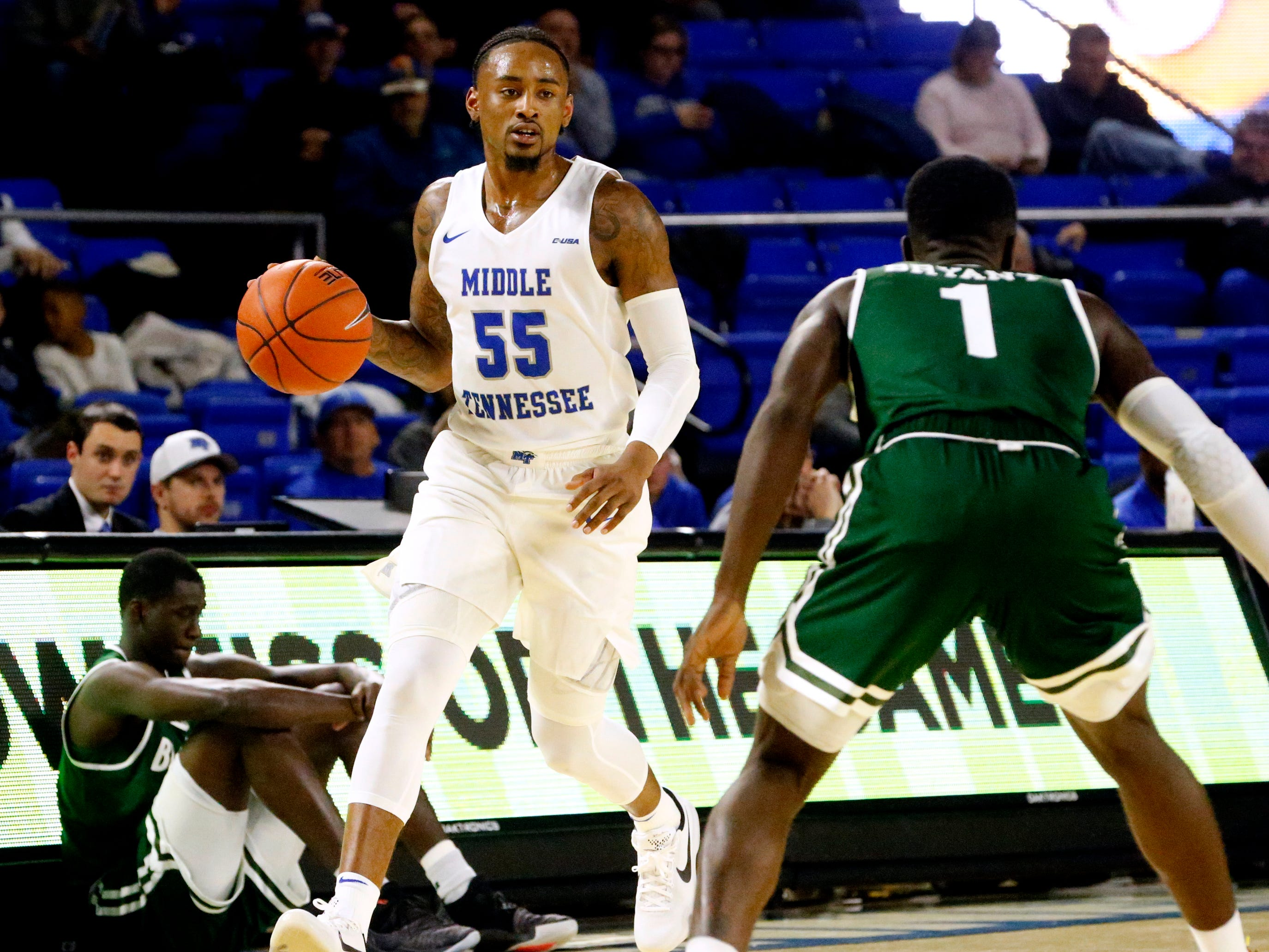 MTSU guard Antonio Green (55) brings the ball down the court as UAB's guard Zack Bryant (1) guards him on Wednesday Jan. 30, 2019.