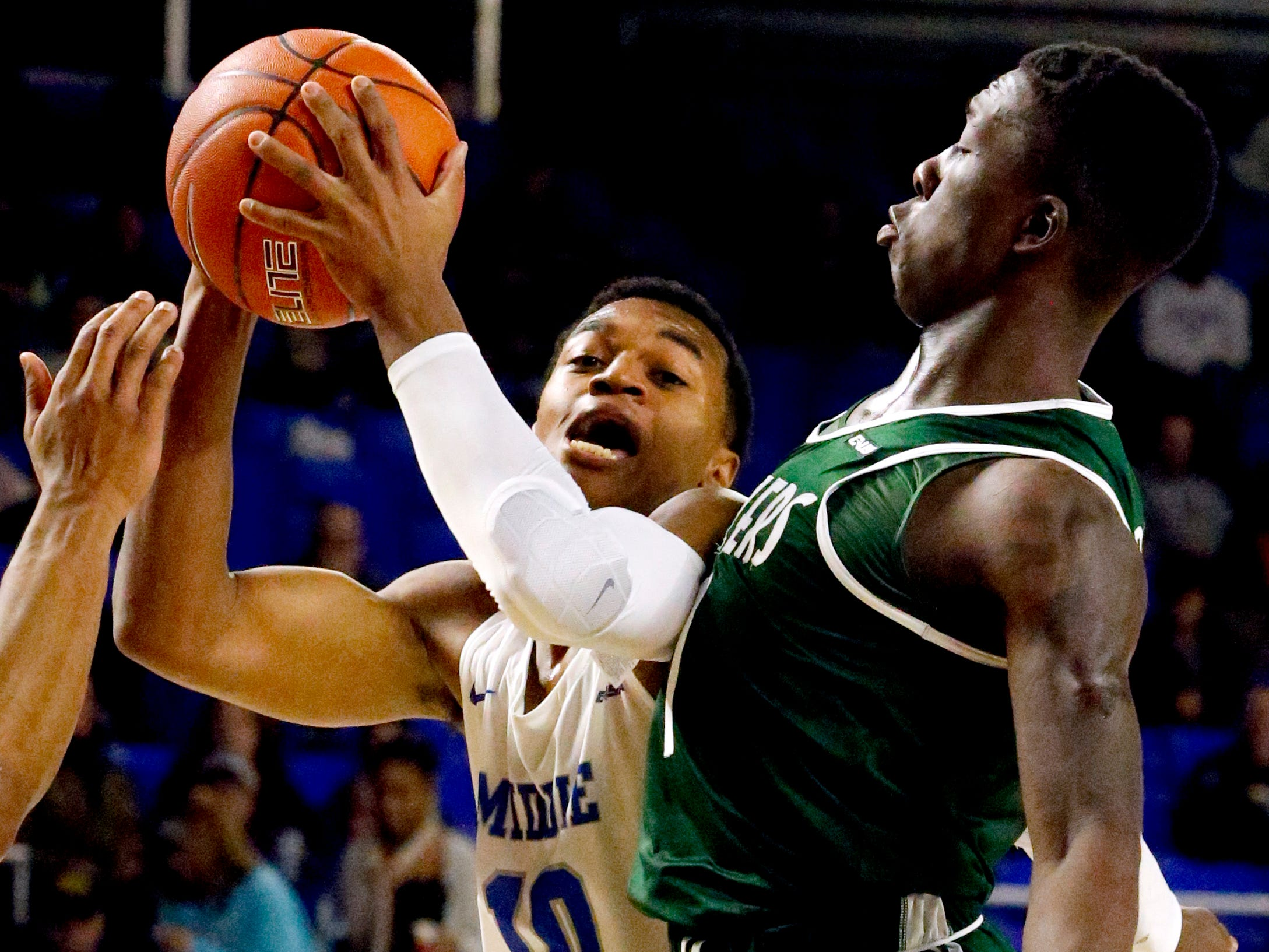 MTSU guard Jayce Johnson (10) goes up for a shot as UAB's guard Zack Bryant (1) guards him on Wednesday Jan. 30, 2019.
