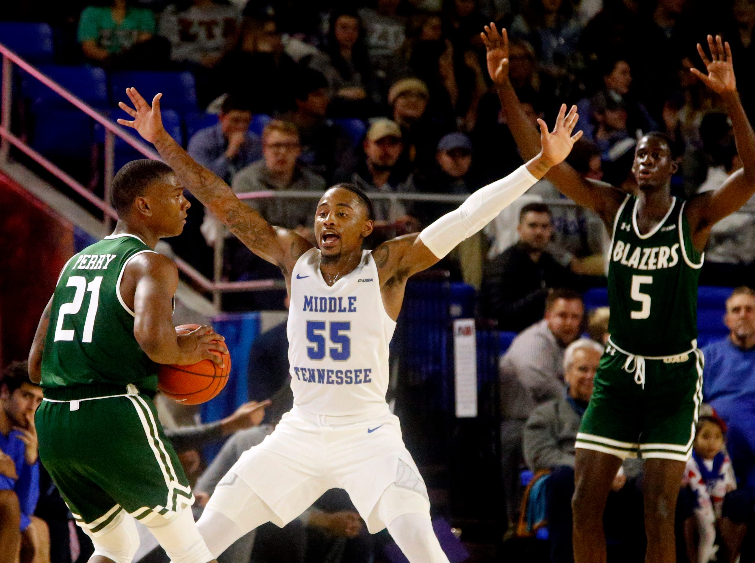 MTSU guard Antonio Green (55) guards UAB's guard Jalen Perry (21) as he looks for a player to pass to on Wednesday Jan. 30, 2019.