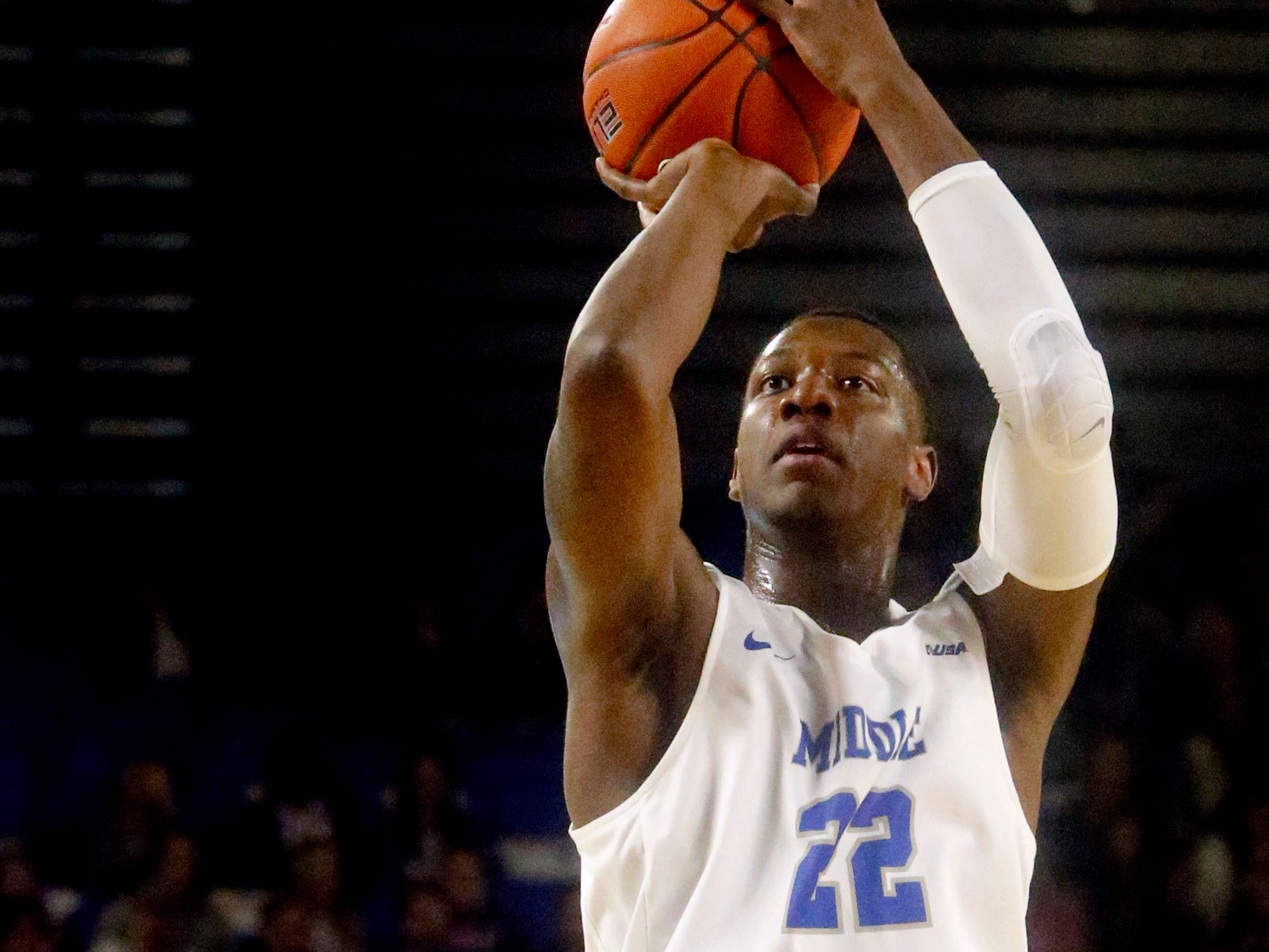 MTSU forward Reggie Scurry (22) shoots a three point basket during the game against UAB on Wednesday Jan. 30, 2019.
