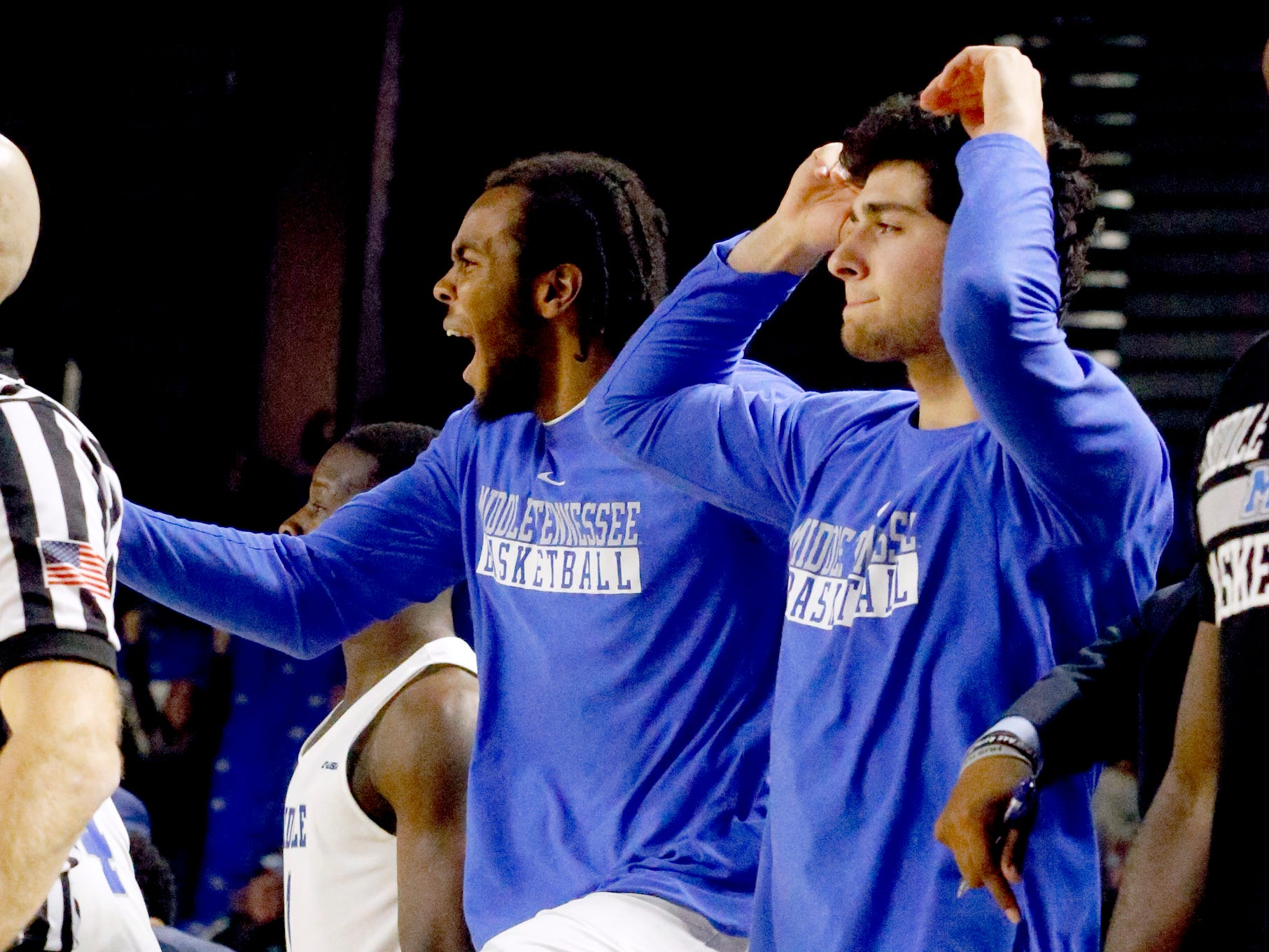 MTSU forward TJ Massenburg (15) and MTSU guard Chase Miller (14) celebrate MTSU guard Donovan Sims (3) making a three point basket against UAB late in the second half on Wednesday, Jan. 30, 2019.