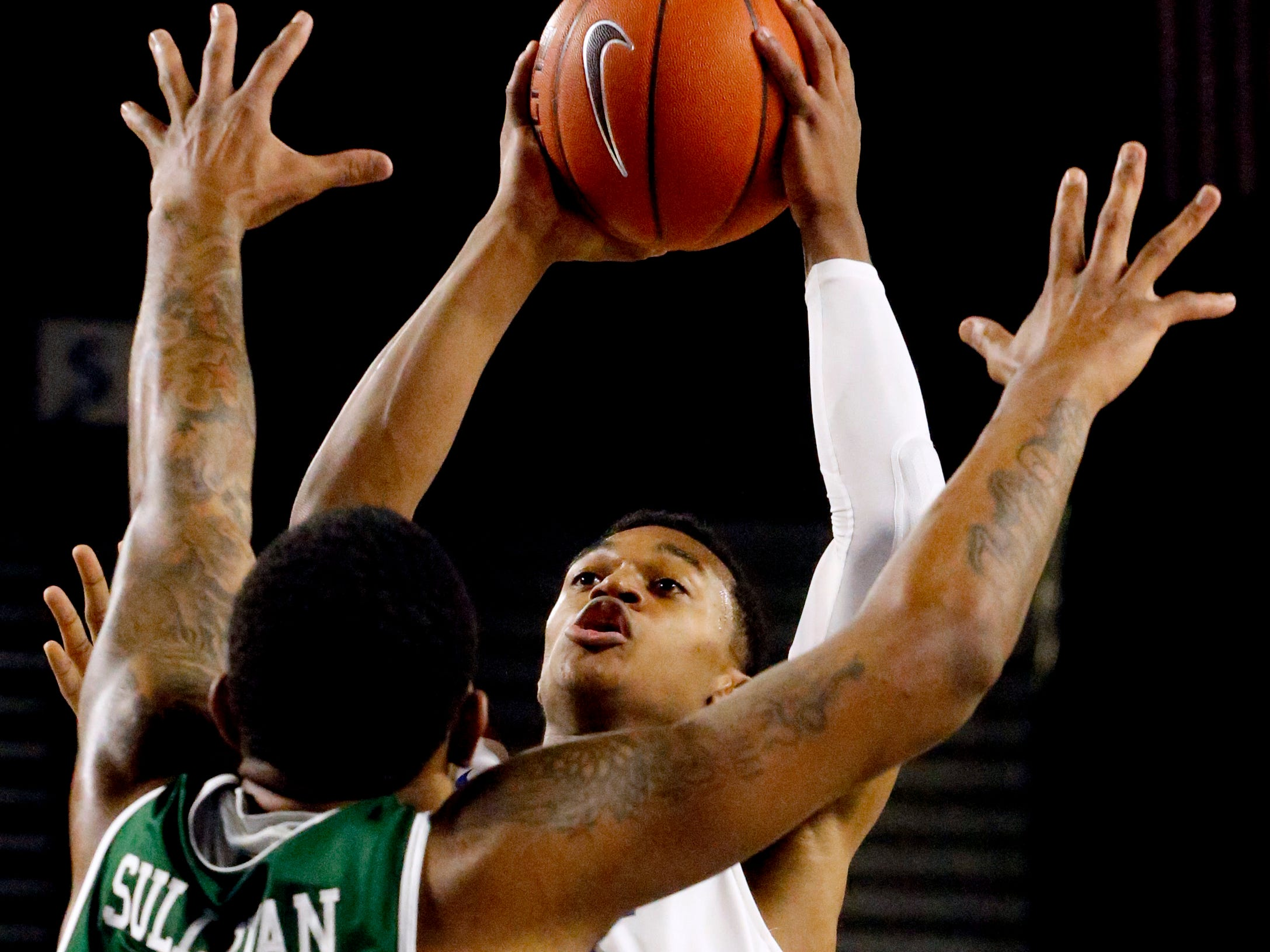 MTSU guard Jayce Johnson (10) goes up for a shot as UAB's forward Lewis Sullivan (23) guards him on Wednesday Jan. 30, 2019.