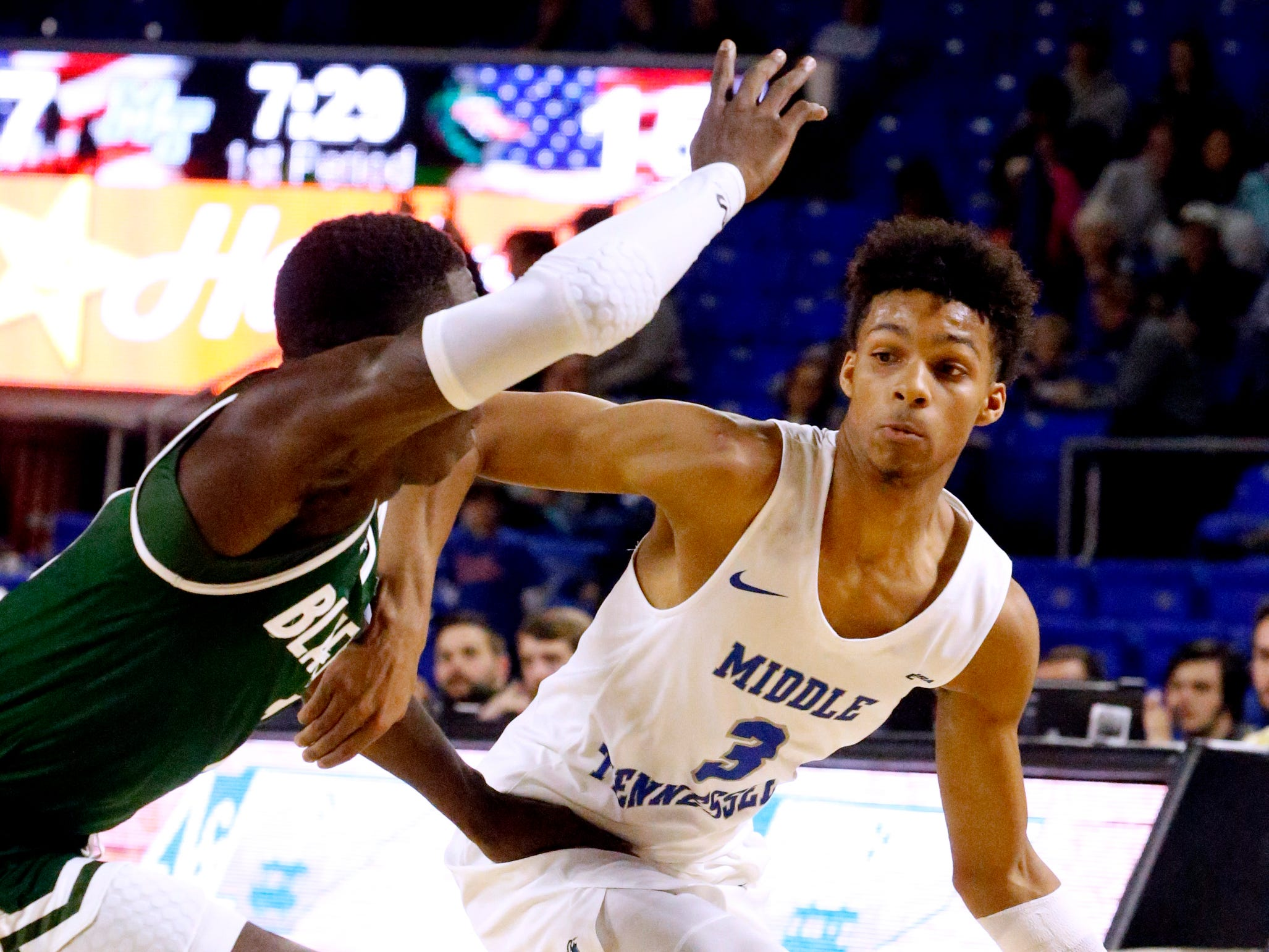 MTSU guard Donovan Sims (3) drives to the basket as UAB's guard Zack Bryant (1) guards him on Wednesday Jan. 30, 2019.