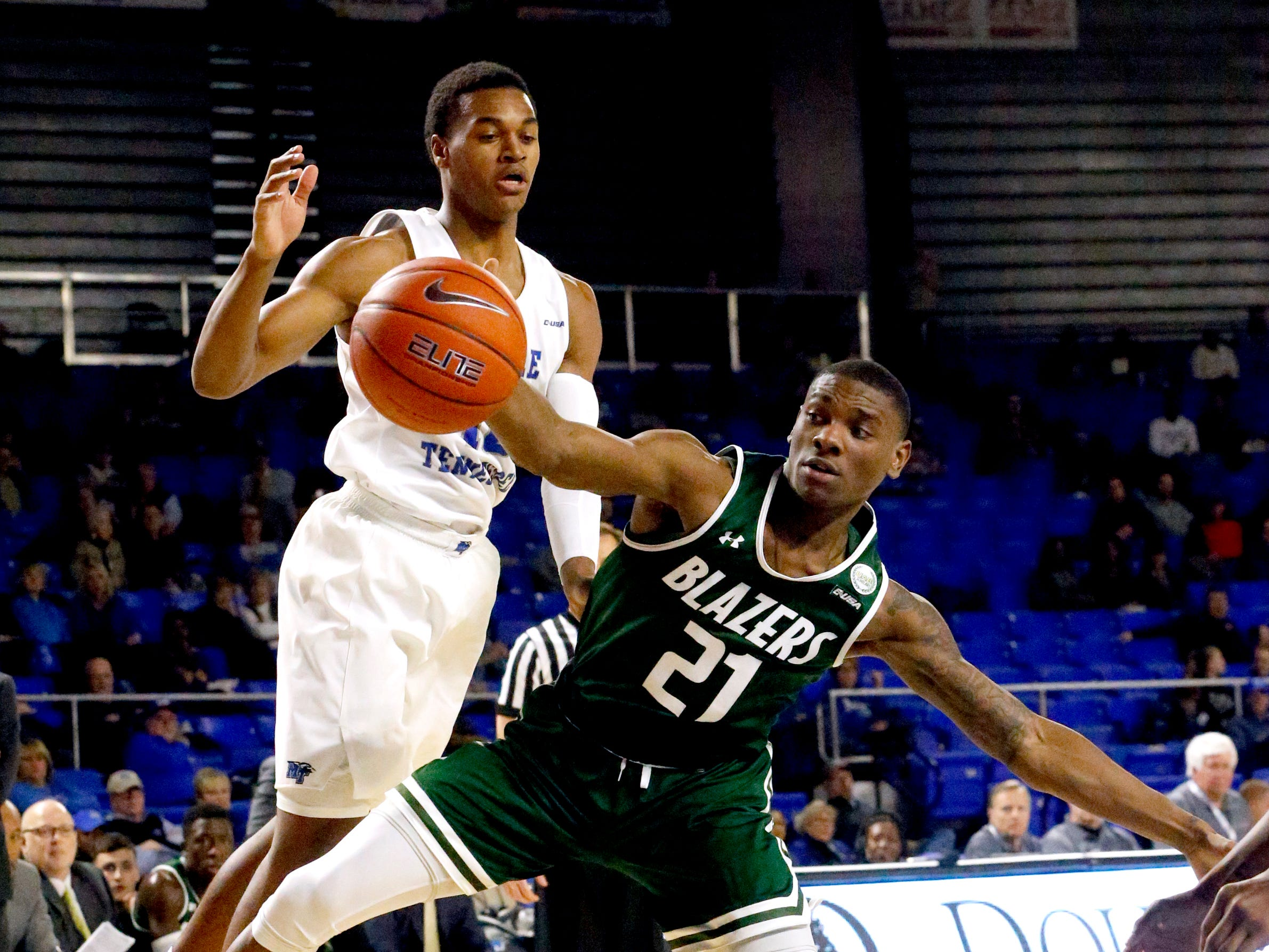 MTSU guard Jayce Johnson (10) and UAB's guard Jalen Perry (21) both go after a rebound on Wednesday Jan. 30, 2019.