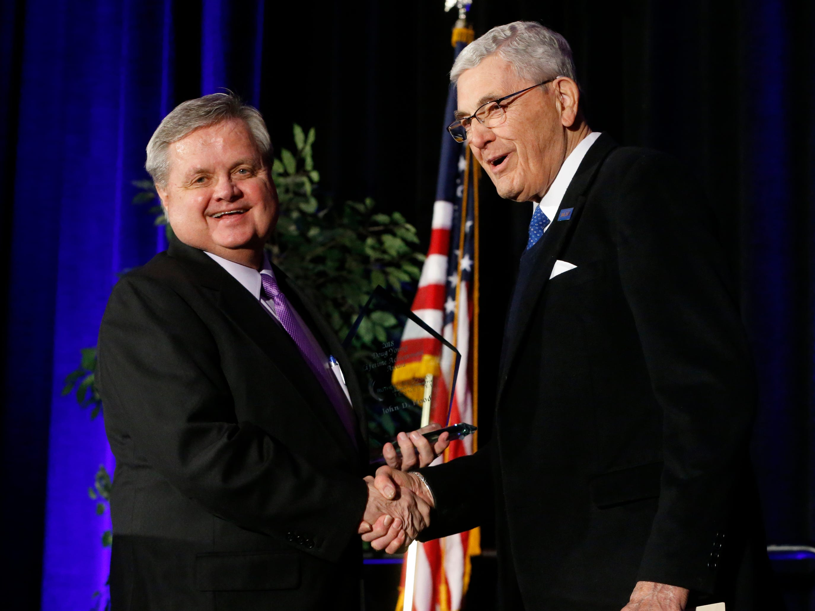 Mark Pirtle, left presented this year's Doug Young Lifetime Achievement Award at Business to John Hood. right at Its Best was held on Wednesday, Jan. 31, 2019 at Embassy Suites.