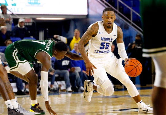 MTSU guard Antonio Green (55) moves around UAB's guard Zack Bryant (1) during the game on Wednesday Jan. 30, 2019.