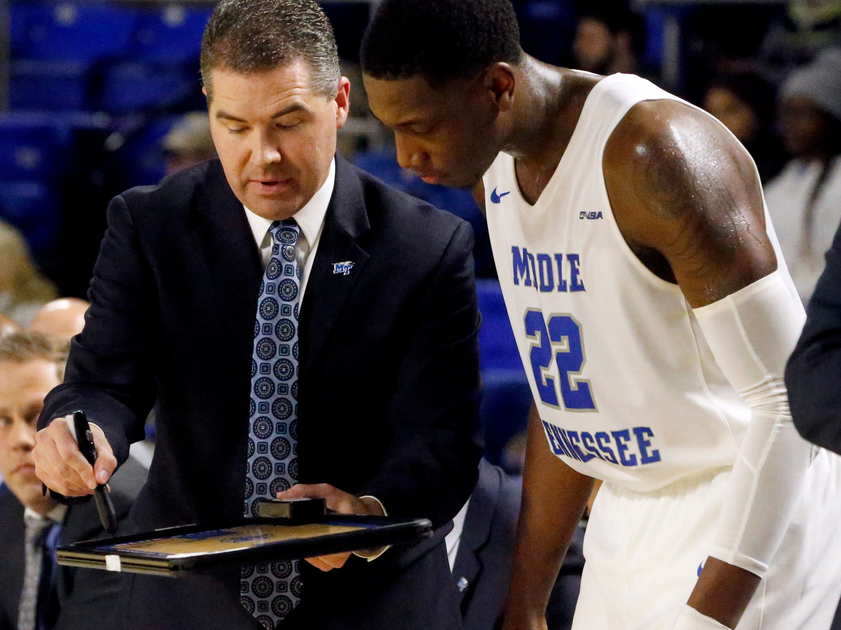 MTSU head coach Nick McDevitt on the sidelines with MTSU forward Reggie Scurry (22) during a time-out in the game on Wednesday Jan. 30, 2019.