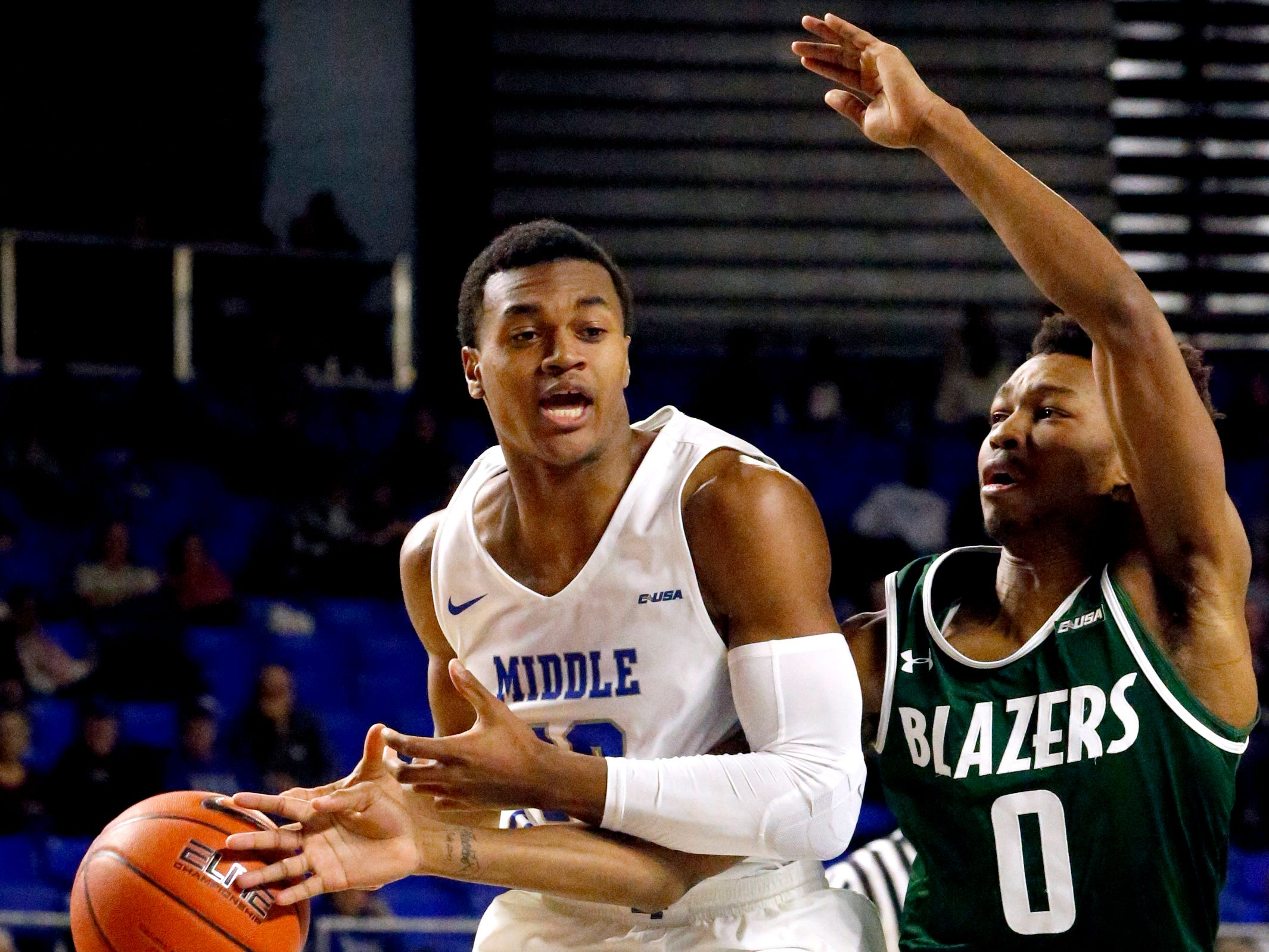 MTSU guard Jayce Johnson (10) goes up for a shot as UAB's guard Tyreek Scott-Grayson (0) knocks the ball out of his hands on Wednesday Jan. 30, 2019.