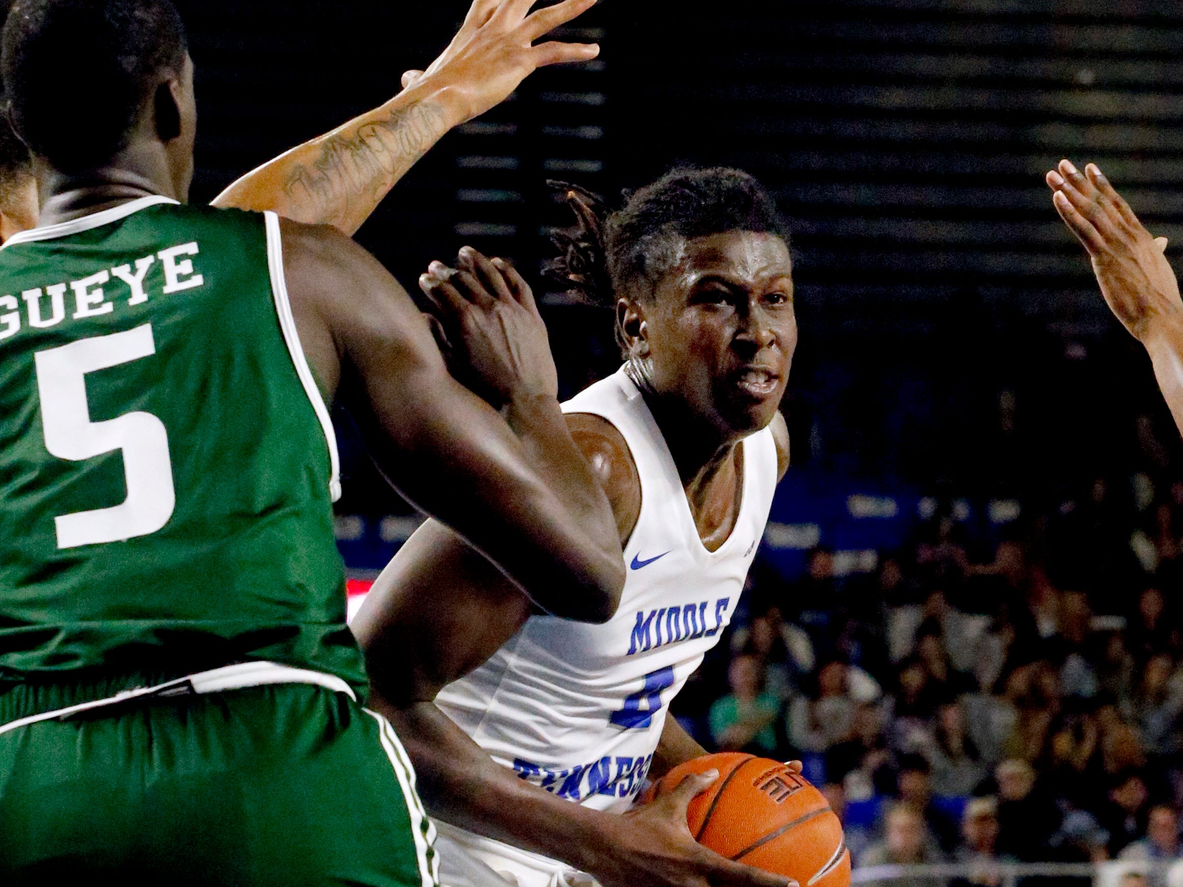 MTSU forward James Hawthorne (4) goes up for a shot as he is guarded by UAB's forward Lewis Sullivan (23) and UAB's forward Makhtar Gueye (5) on Wednesday Jan. 30, 2019.