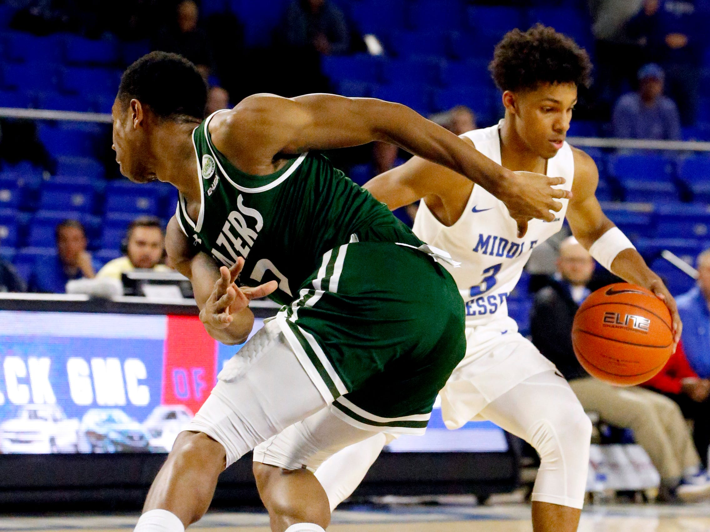 MTSU guard Donovan Sims (3) moves around UAB's guard Jeremiah Bell (2) as he gets in position to shoot a three point basket on Wednesday, Jan. 30, 2019.