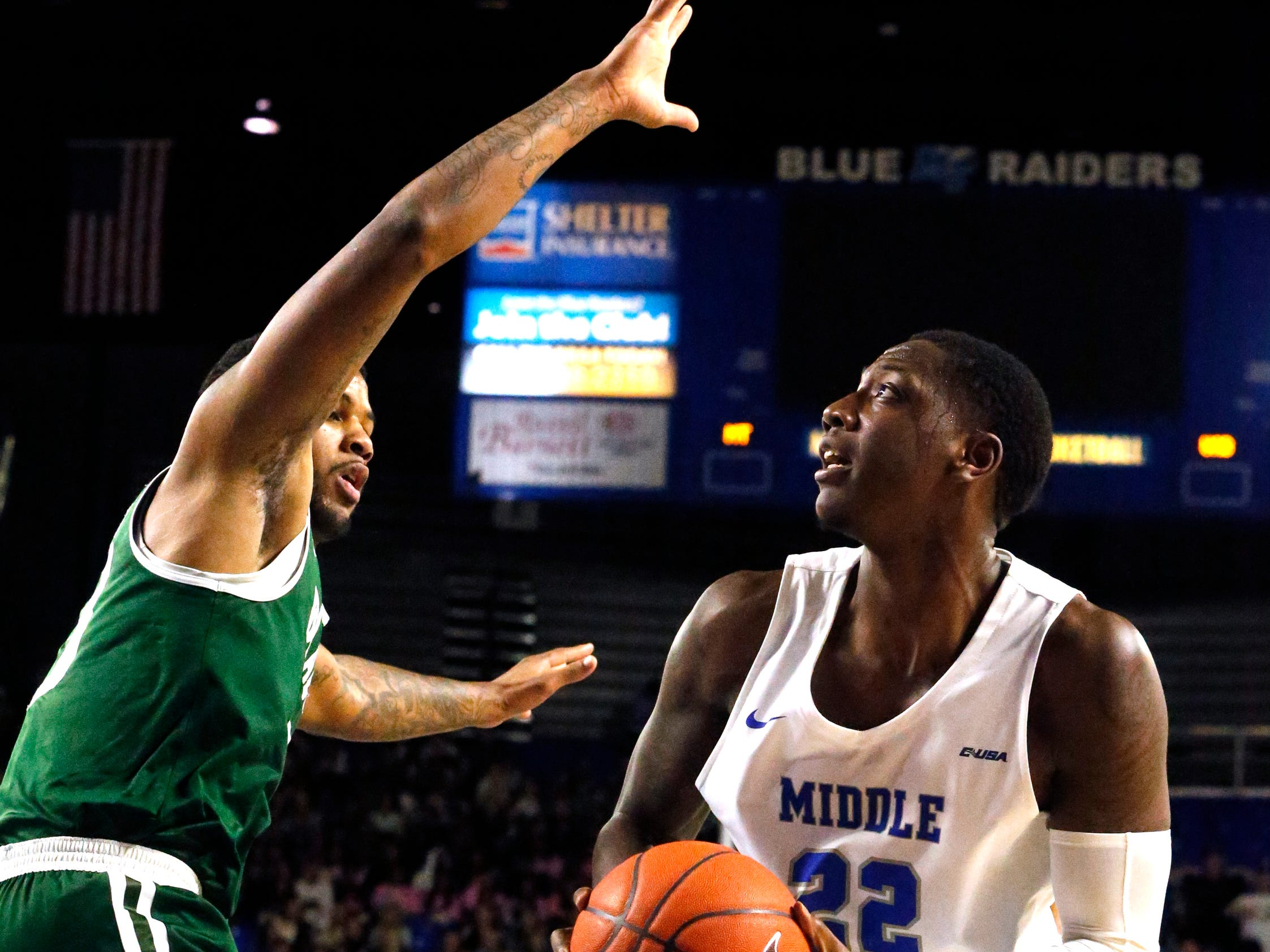 MTSU forward Reggie Scurry (22) goes up for a shot as UAB's forward Lewis Sullivan (23) guards him on Wednesday Jan. 30, 2019.