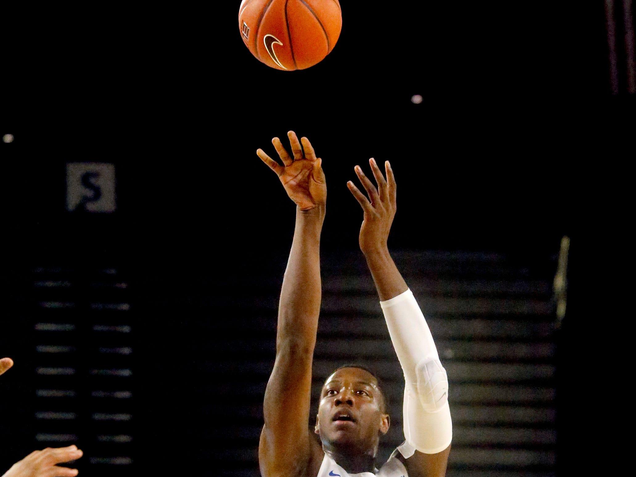 MTSU forward Reggie Scurry (22) shoots a three point basket against UAB on Wednesday Jan. 30, 2019.
