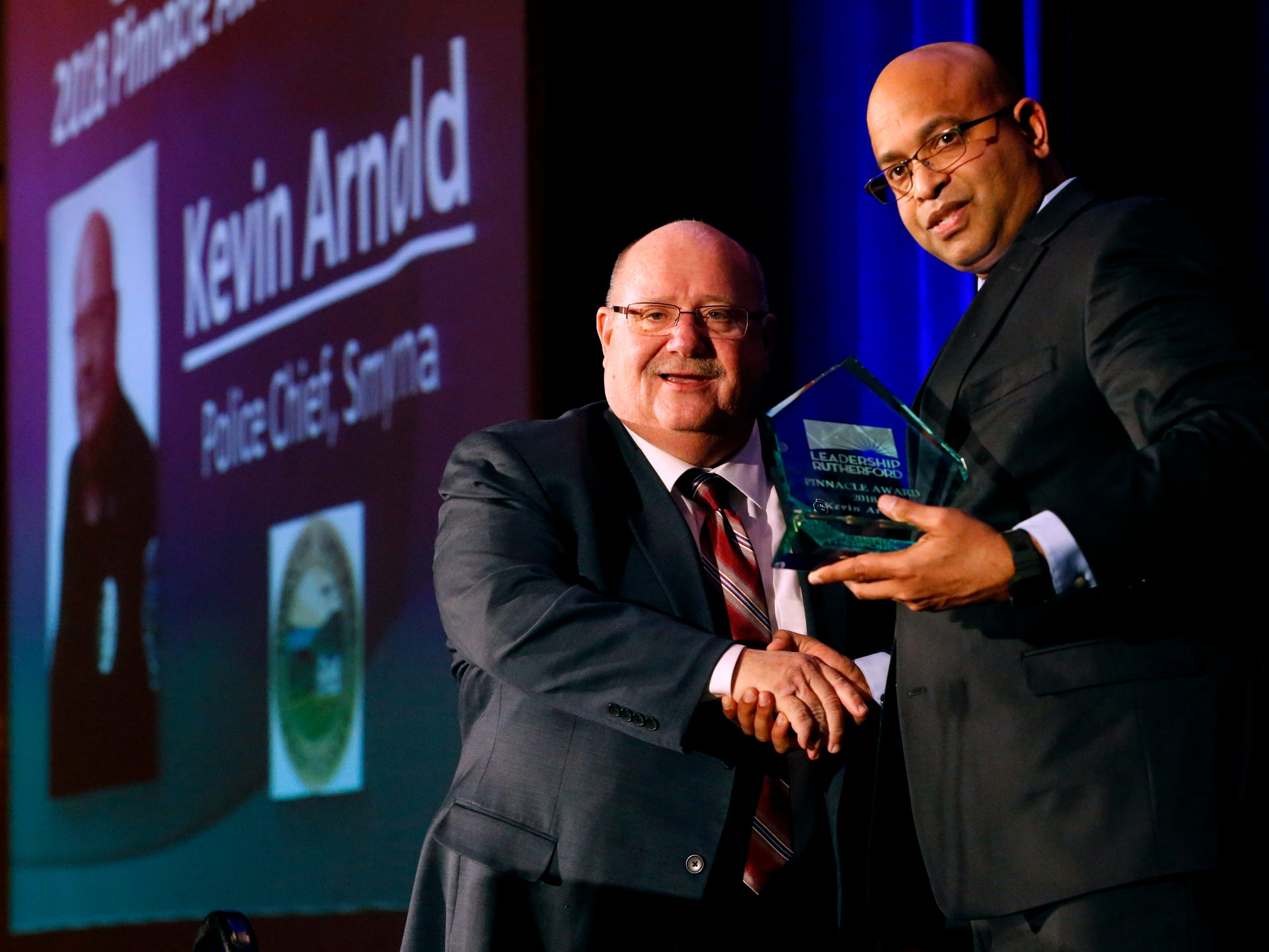 Dane Appalsammy, left presented this year's Leadership Rutherford Pinnacle Award to Chief Kevin Arnold, right at Business at Its Best that was held on Wednesday, Jan. 31, 2019 at Embassy Suites.