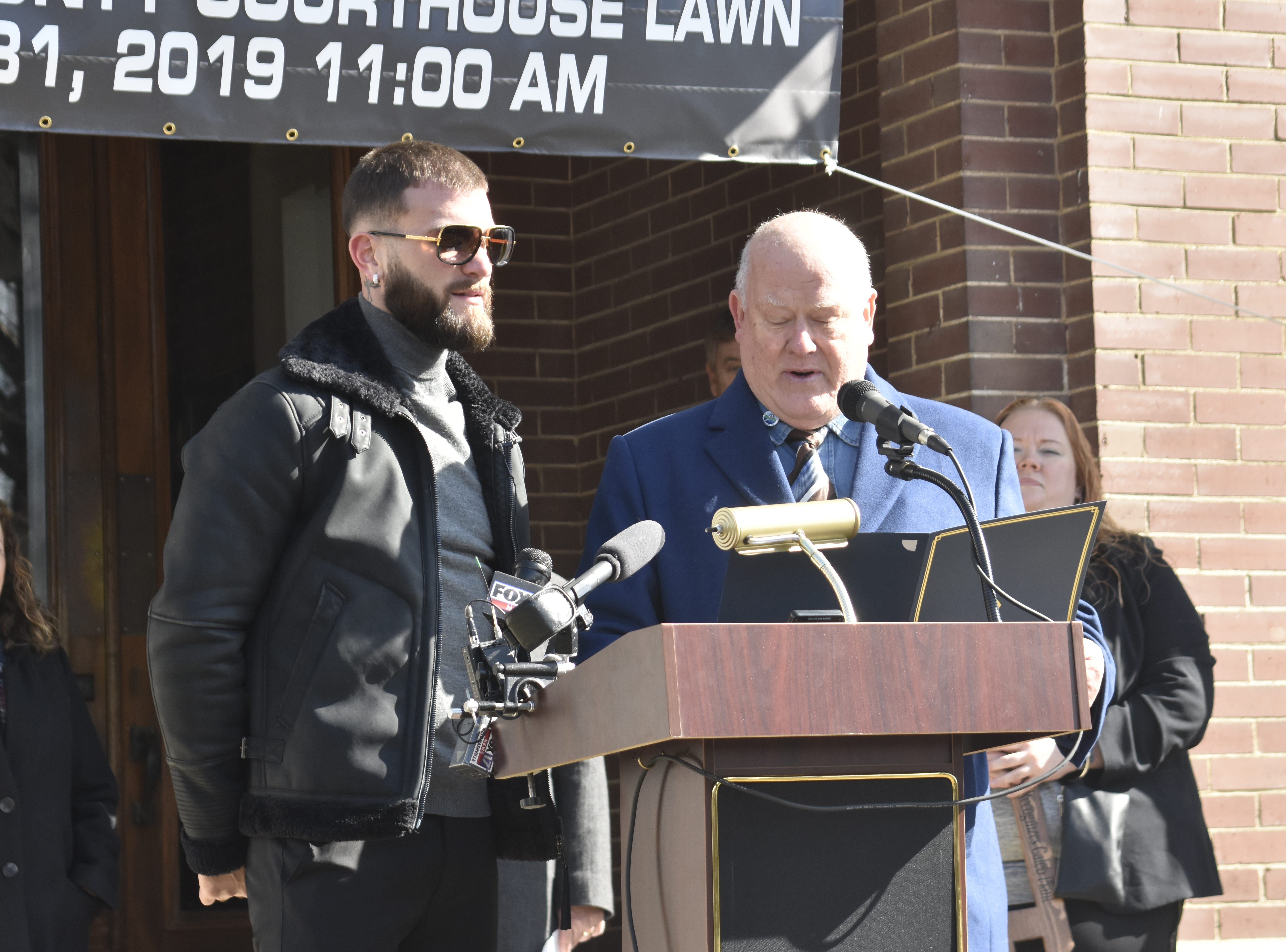 """Ashland City Mayor Steve Allen read a proclamation for Caleb """"Sweethands"""" Plant at the Cheatham County Courthouse on Thursday, Jan. 31."""