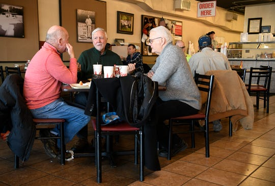 David Bradford, Gary Mills and Steve Smith enjoy lunch at Dairy King on Jan. 30.