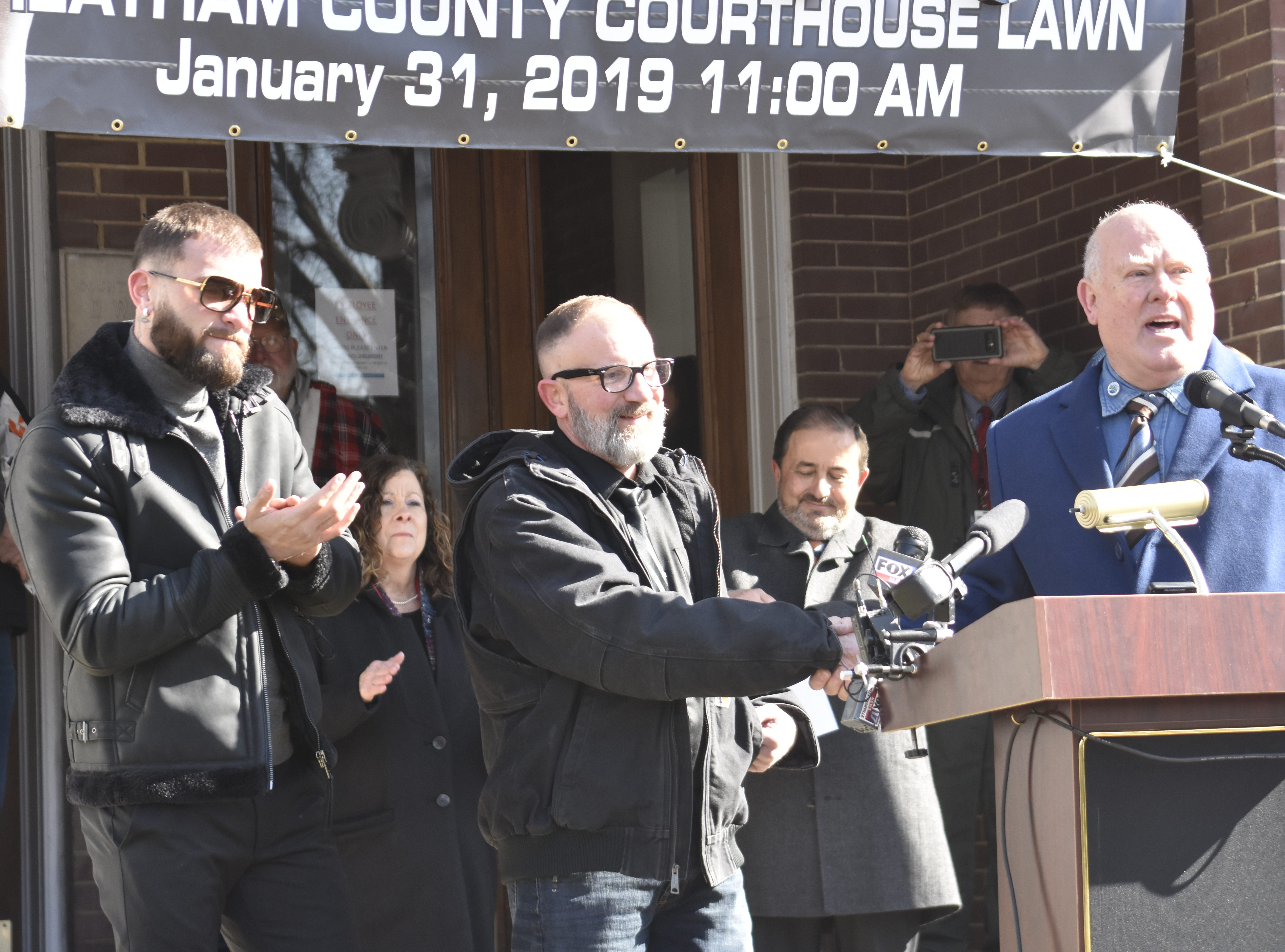 """Ashland City Mayor Steve Allen (right) recognized Richie Plant (center) and Caleb """"Sweethands"""" Plant (left) at the Cheatham County Courthouse on Thursday, Jan. 31."""