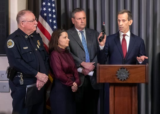 US Attorney Don Cochran displays a seized gun that had been traced to a crime during a press conference at the Mayor's Office to announce a combined effort with local and federal law enforcement to identify and remove guns used in crimes Thursday, Jan. 24, 2019.