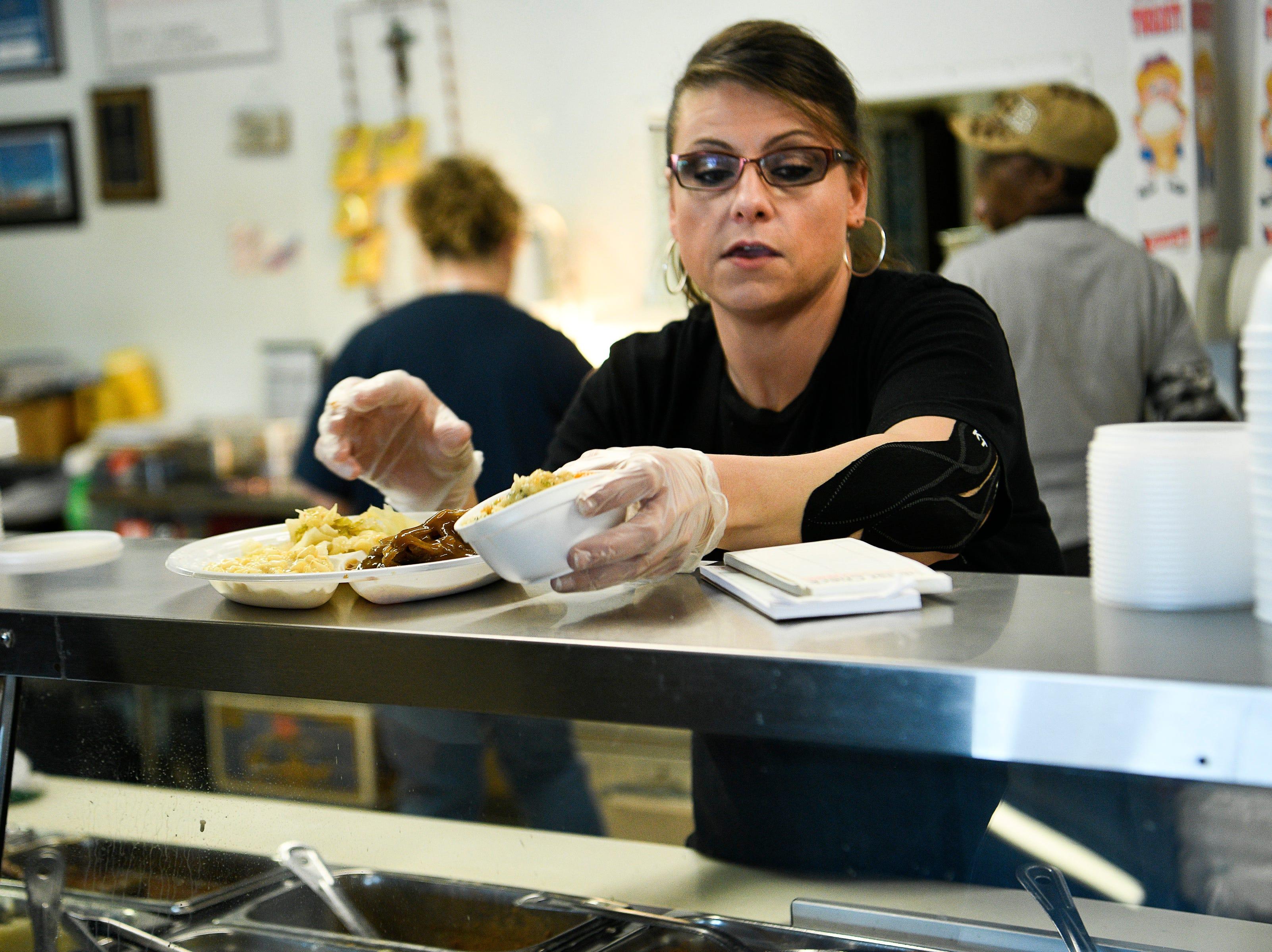 Bobbie Jo Allardice serves food to customers at Dairy King  Wednesday Jan. 30, 2019 in Nashville, Tenn.